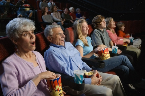 People Watching Movie in Movie Theatre